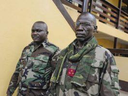 Le général du FPRC Noureddine Adan et son garde du corps.